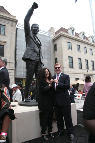 South African born Saul Levin Medical Director and CEO Designate of the American Psychiatric Assoc. With Melanie Nathan holding a Mandela COIN gift from the SAGCE